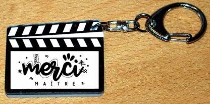 Un porte-clés cadeau maître style clap cinéma avec agda photo
